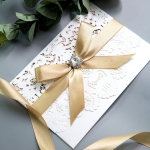 Exclusive Ivory  Laser Cut Wedding Invitation with blush pink paper and  Crystal Button Ribbon Bow WS002
