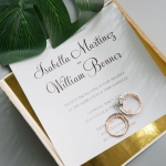 Fabulous Rose Gold  Laser Cut Wedding Invitation with Glittery Navy Ribbon Bow and Gold Mirror Paper Backer WS003