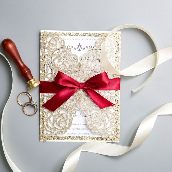 /1067117-2544-thickbox/classic-gold-shimmer-glittery-laser-cut-wedding-invitations-with-red-ribbon-bow-ws018.jpg
