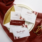White vellum wedding invitations with burgundy belly band, watercolor floral design, white free envelopes with gold glitter backer, luxury wedding invitations ws037